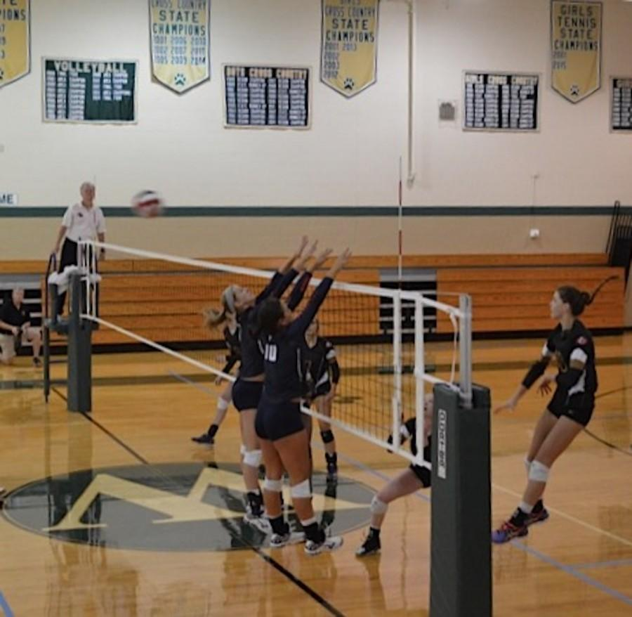 Parrish goes up for a block against her opponent. NC will miss her on-court presence.