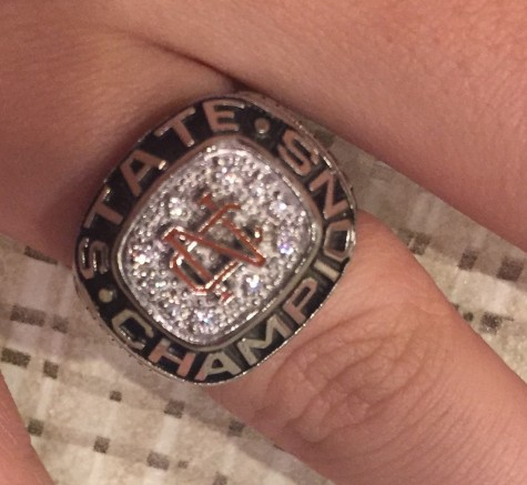 Parrish flaunts her state championship ring, representing NC's only athletic championship within the last 30 years.