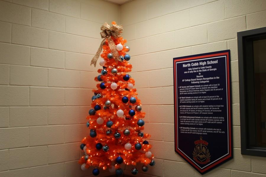 Due+to+the+Spirit+of+the+Season%2C+the+Freshman+Academy+office+displays+its+North+Cobb+orange+and+blue+decorated+Christmas+tree.
