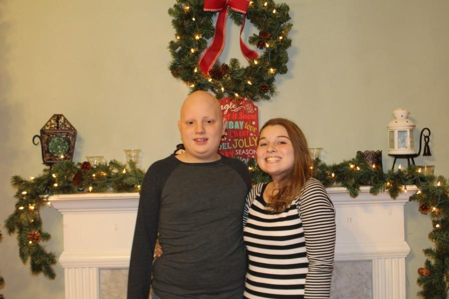 Michael (left) and sister Cydnee (right) celebrate the holiday season together.