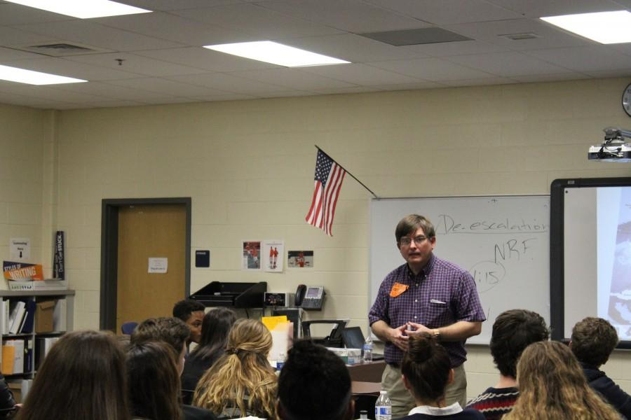 KSU Professor Stephen McKelvey speaks to the North Cobb Magnet Seniors in the Freshman ID Lab about current events regarding Russia and ISIS.