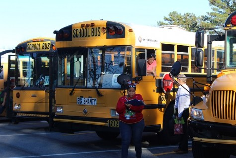 A bus driver takes check of procedures before giving the go-ahead to other buses.