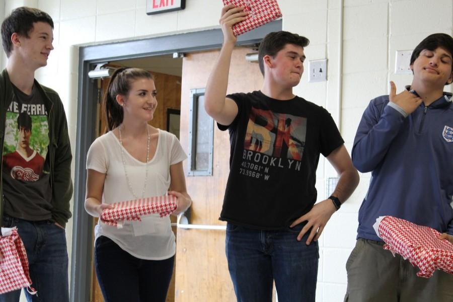 "Senior Collin Cook, and Juniors Autumn Boekeloo, Giovanni Merendino and  Mahmoud Sarris partook in Mr. Dempsey's ""Wrap Battle"" during C lunch. Students had to wrap presents and were judged on speed and neatness. Merendino came out victorious with Boekeloo coming in second and Sarris third. Cook ended up coming in 4th place, which was also last. Students then got to keep the items that were in the boxes they wrapped. These items varied from candy to coal."