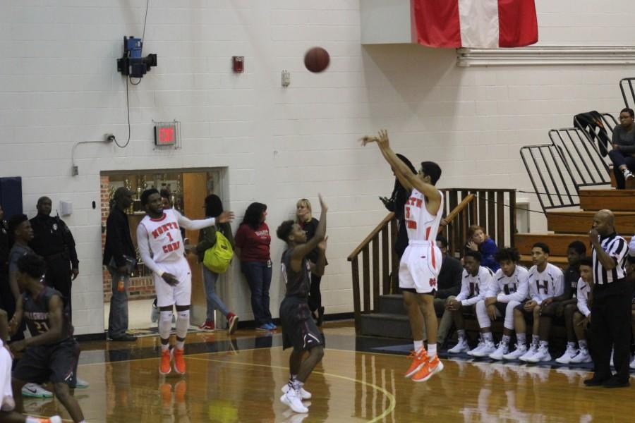 On Friday night, the Warriors battled the Hillgrove Hawks, a team now 2-6 after losing to North Cobb. Guard Myles Pond (#3) sinking a three-pointer in the second quarter of the game. Despite their best efforts, the Hawks were defeated by the Warriors 56-50.