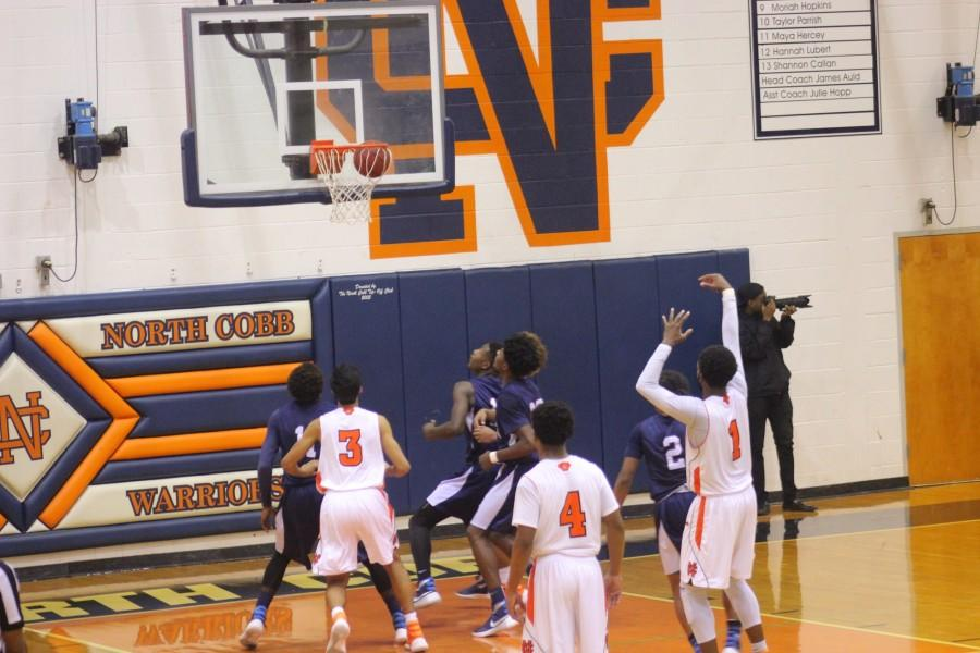 Last night, North Cobb faced off against the Marietta Blue Devils. Here, guard Kenny Ume sinks a free throw during the third quarter. Ume scored 12 points throughout the quarter, helping secure a win for NC. The Blue Devils fell to the Warriors 39-33.