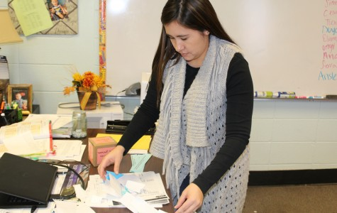 """New Spanish teacher Lorna Fair-Tham sorts papers while her students eat lunch. """"She makes sure everyone understands the work and that we understand what is expected of us,"""" said junior Brittany Ent."""