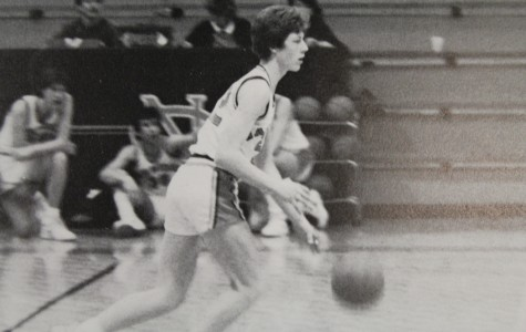Varsity basketball player, Mark Rogers, brings an end to the Warrior and Raider face off in 1987.