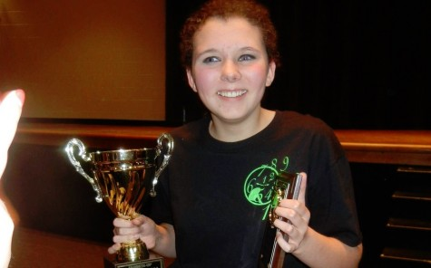 Franks poses with her Best Actress award and the Second Place trophy that NC won her sophomore year for the one act play These Shining Lives.