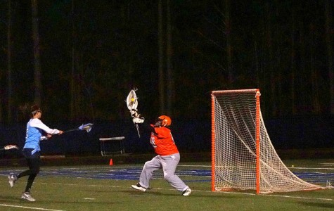 Chandler blocks the lacrosse ball as it heads towards the goal. Chandler thus far possesses 241 career saves.