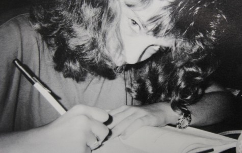 A 1989 NC student works diligently on her class work as her classmates around her work on the lesson.
