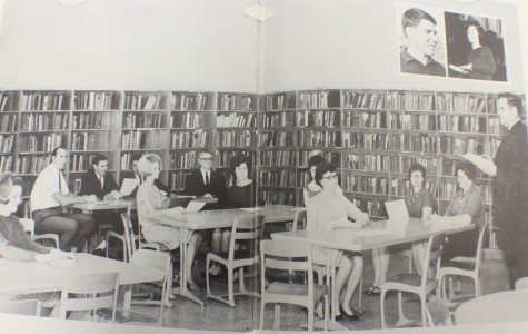 A group of NC teachers discuss the upcoming school year during a faculty meeting in the library in 1960.
