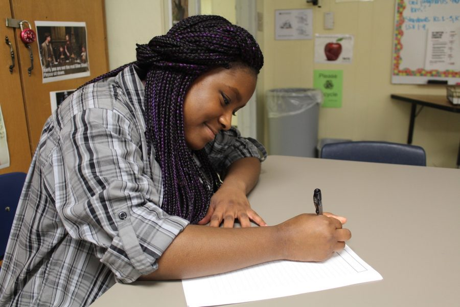 Junior Imani Bryant practices writing an essay like she must at the Governor's Honors interview for county and state.