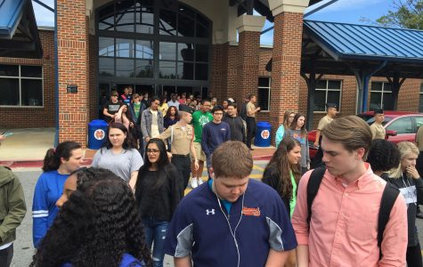 An unexpected fire drill during lunch sent students rushing out of the building. Although everything turned out fine, it made the Friday before prom interesting.