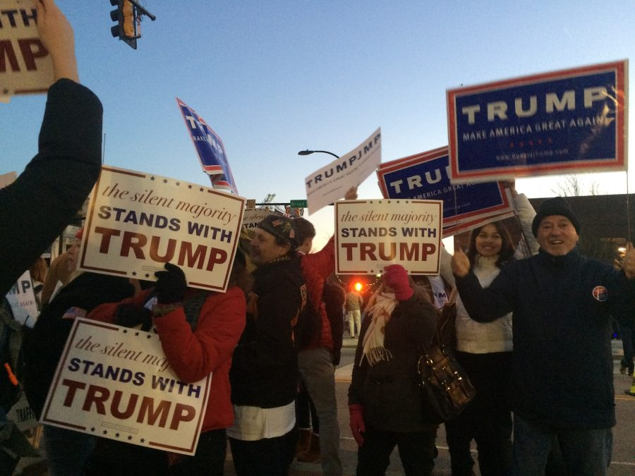 Outside the Greenville GOP debate, Trump supporters rep their signs and gear foreshadowing the support following Trump into the primary season.