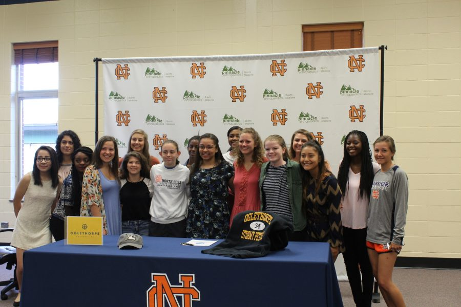 This morning, senior Jordan Chandler signed to Ogelthorpe University in Atlanta to play lacrosse. Jordan is surrounded by her fellow lacrosse players as they celebrate this new decision.