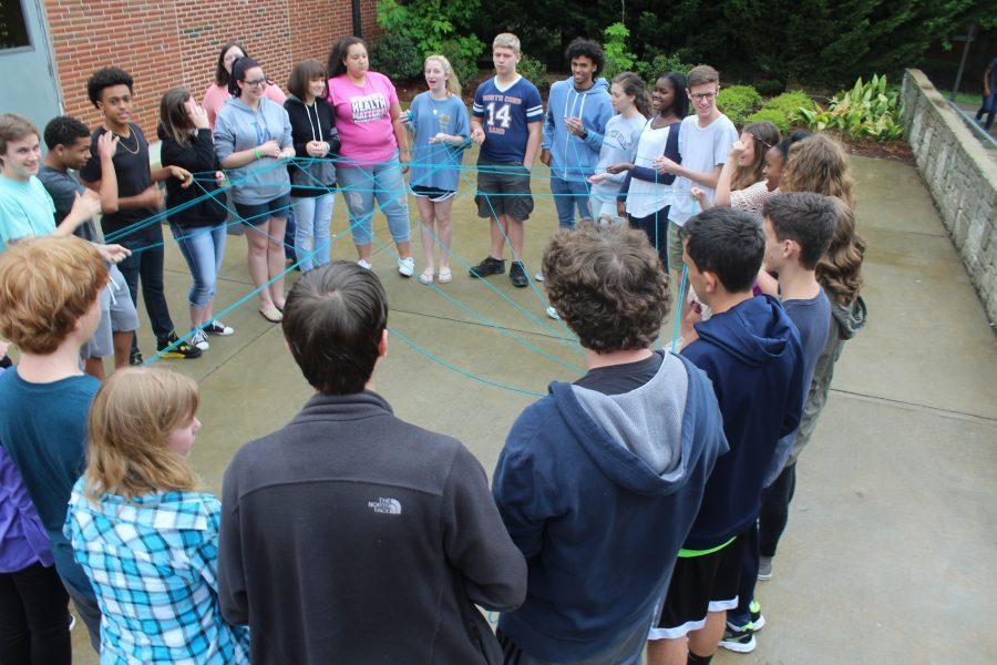 Ms. Galloway's Sophomore AP World History class takes learning outdoors today when talking about the Alliances that caused World War I using strings. The strings get pulled tightly till they break simulating how the war began.