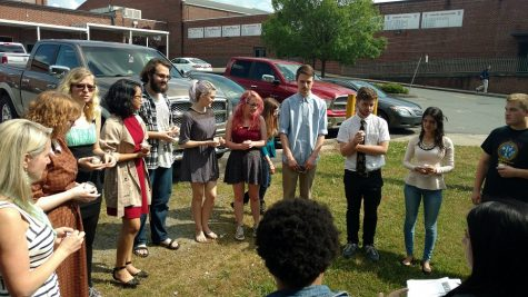 Newly inducted Thespians say the sacred oath that officially inducts them into the International Thespian Society.