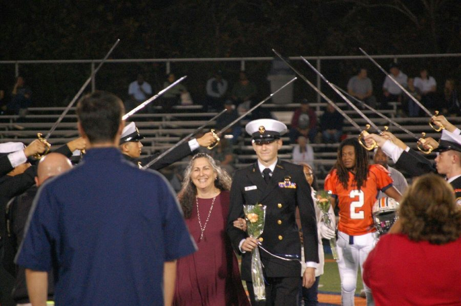 Accompanied by his mom, Wilson receives recognition for his four years of participation in the NC NJROTC on Senior Night.