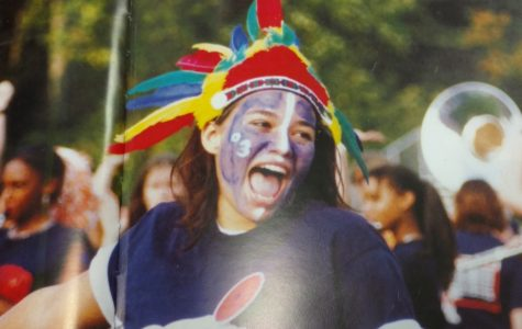 A student displays her avid school spirit at a football game in the spirit section of a 2003 edition of NC's yearbook.