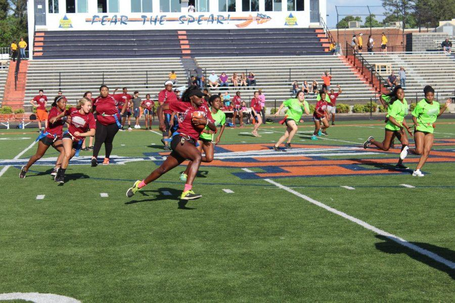 Senior Franchesca Voltaire running the ball down the field during the second game of the tournament. Voltaire, also a track star, made a majority of the touchdowns for the senior class