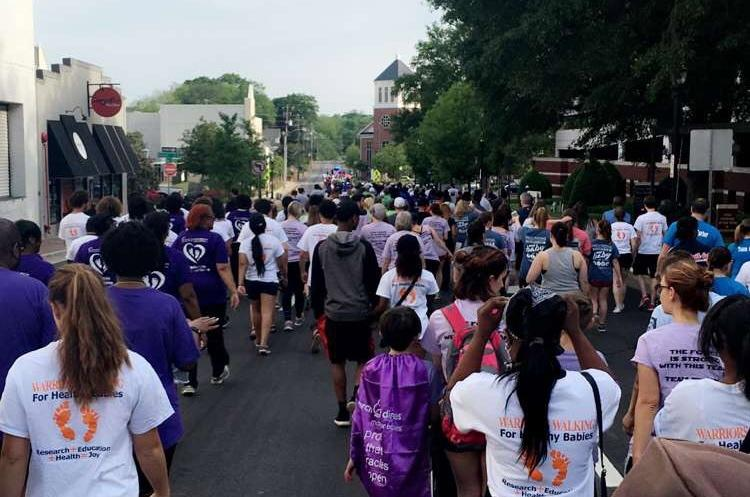 Walkers begin the 5K on Church Street in Marietta. NHS can be distinguished wearing their custom white March of Dimes t-shirts.