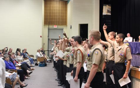 """""""Pinkies Up!,"""" the cadets chant as they celebrate the awards they earned as a unit."""