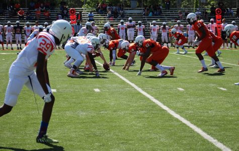 Last Friday, the Warrior football team battled against themselves in the spring game. Half of the team wore white jerseys, while the other half sported orange.