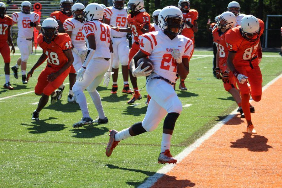 Sophomore defensive back Elisha Linley scoring a touchdown for the white team. Linley, among others, helped the white team secure their win, defeating the orange team by six points.