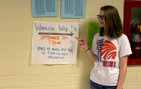 "Senior Cross Country member Audrey Widmier promotes the Warrior Way 5K, which will take place on Saturday, September 17 at 7:30 a.m. See any Cross Country runner or coach to fill out an entry form. ""We'd love for anyone to come out and run. Have fun, get fit,"" Head Coach John Huff said."