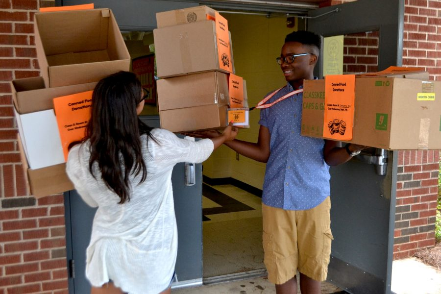 Tribal Connections (TC) carries boxes to each class for canned food collection. Each first period will collect cans for the Taste of Kennesaw drive.
