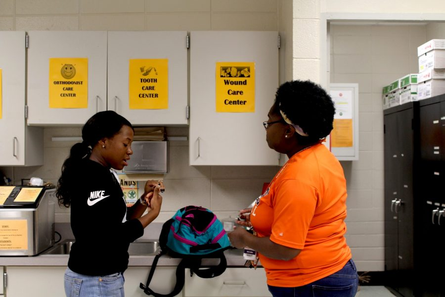 """Certified employee of the year and NC's nurse Fikera Gerald takes on the year giving students advice about how to protect from flu season. """"I suggest students drink lots of water, get plenty of rest, and bring over the counter medicine when sick. Also, do not come to school when you have a fever,"""" Gerald said."""