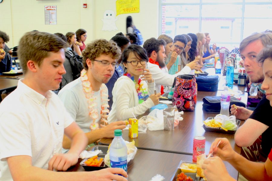 """As the school year approached, NC seniors communicated over social media to arrange an outfit all seniors could wear on the first day of the year. After running a poll on Twitter, they agreed to wear a white t-shirt with a lei. Senior Barrett Vance said, """"It's awesome how all of us were able to talk to one another and get to choose an outfit representing our class."""""""