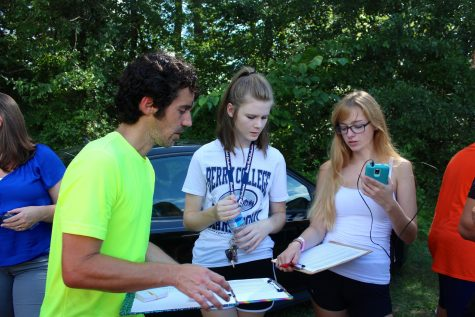 Huff works with the Cross Country team's managers during the time trial last Thursday. Beyond coaching the runners, Huff must also oversee all managers and volunteers.