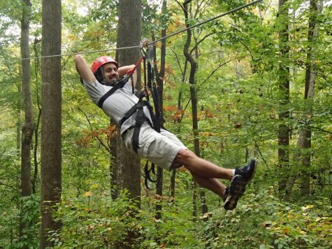 """Huff """"hangs out"""" with the team by ziplining during last year's trip to Furman University."""