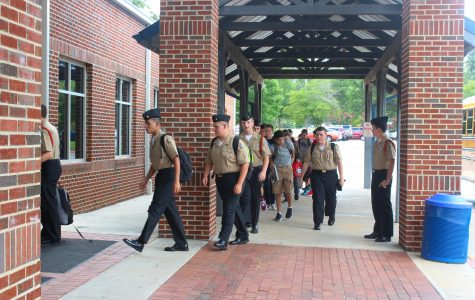 Harrison JROTC students arrive for their daily class with NC's Commander Reeves. Friday means weekly uniform inspection, which indicates whether or not the students take care of their uniforms. The students stroll in with confidence in their appearance, and hope to do well on their inspection.