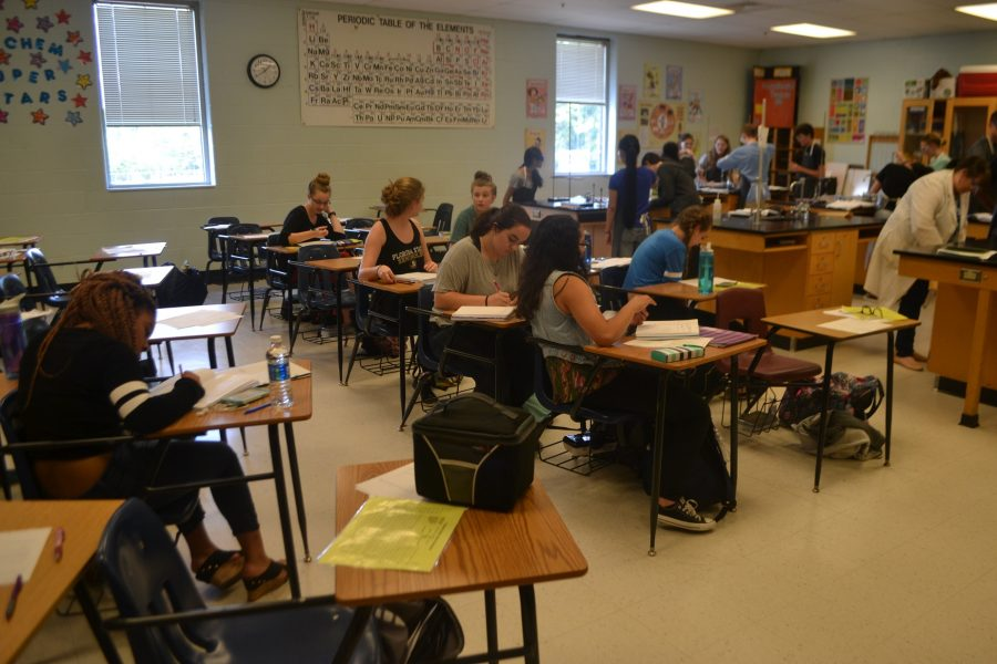 Jordan Tidrick's Warrior Wednesday chemistry class catches up on homework and receives extra help on lessons and labs.