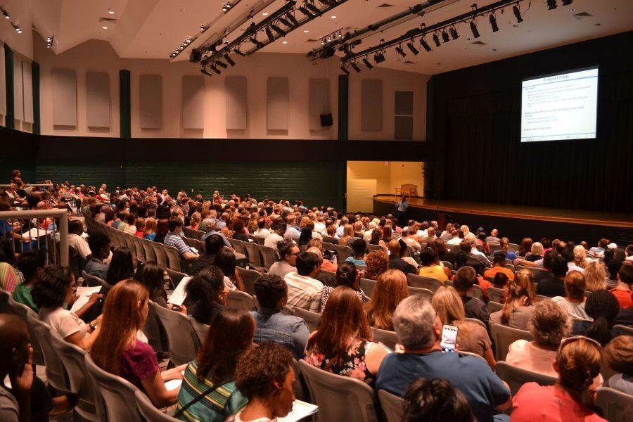 Over 450 students and parents swarm the Kennesaw Mountain High School theater for FAFSA night. Almost every single seat was filled with people eager to hear about federal and state grants for college.