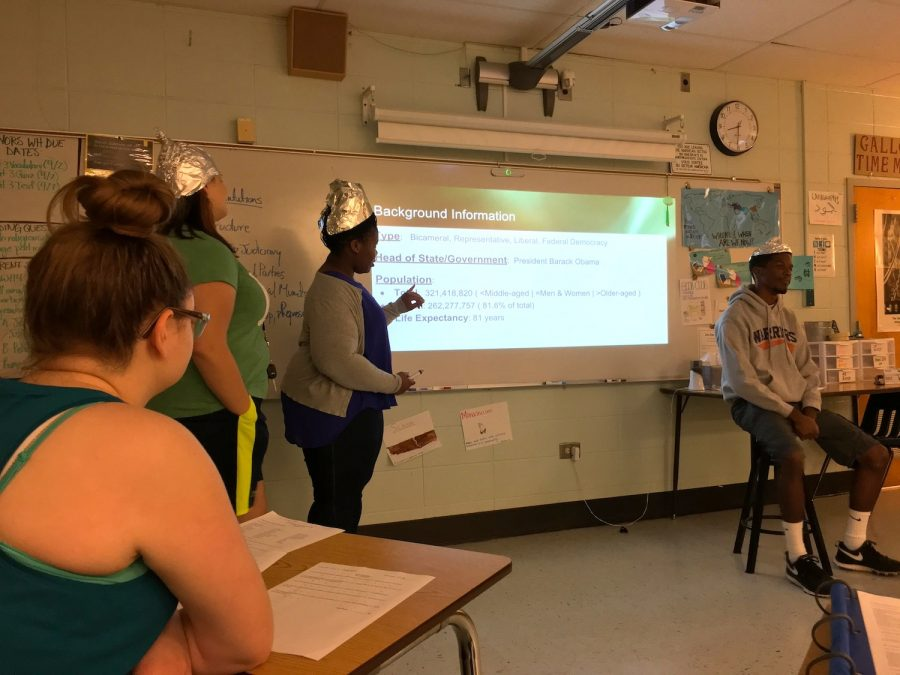 Students in Carol Galloway's AP Comparative Government class don tinfoil hats and act as aliens examining the political structure of the United States. Galloway asked the students to look at the country as outsiders to increase objectivity.