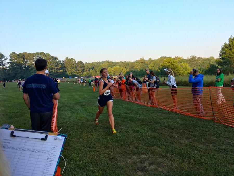 Sophomore Lindsey O'Neill finishes in first place for the junior varsity race.