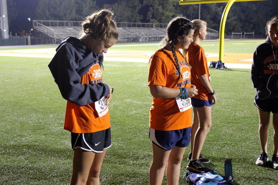 Cross Country members arrive at the school at 6:30 a.m. to set up the race and greet runners.