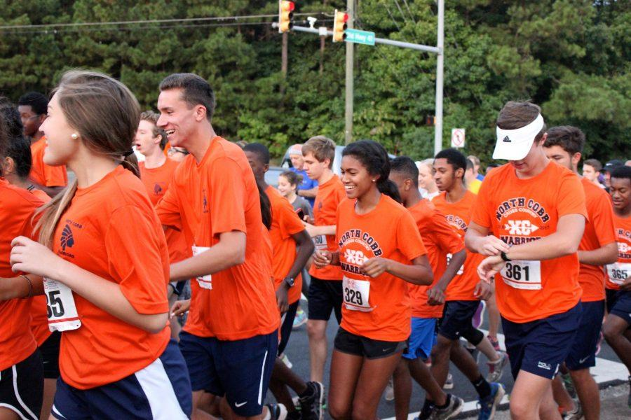 Orange shirts cover Blue Springs Road as the Warrior Nation and community starts the race.