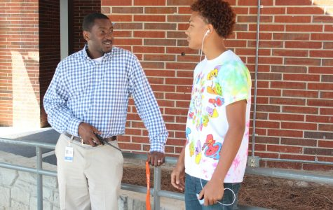 """Southwell only transferred to NC from Russell Elementary this year, and he has already developed a relationship with the students. Senior Josiah Roebuck, pictured talking to Southwell, considers him a helpful addition to administration. """"There used to be a lot of kids just roaming the halls during class, and no one would do anything about it. Now, you rarely see anyone even trying to skip,"""" Roebuck said."""