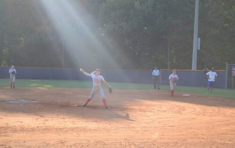 A beam of light shines on senior Julie Sanderlin as she pitches. Only divine intervention can explain NC's victory.