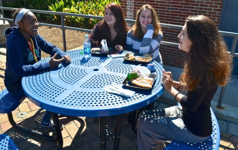 Laughing about the fun antics and activities they participated in, NC students catch up after the weeklong fall break. Now October, a month full of Halloween preparation and scares, junior Marielle Cooper said,