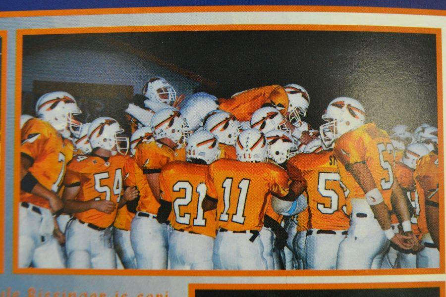 In honor of the last at home football game and Senior Night this Friday, the 2001 yearbook features the varsity football team celebrating a win.