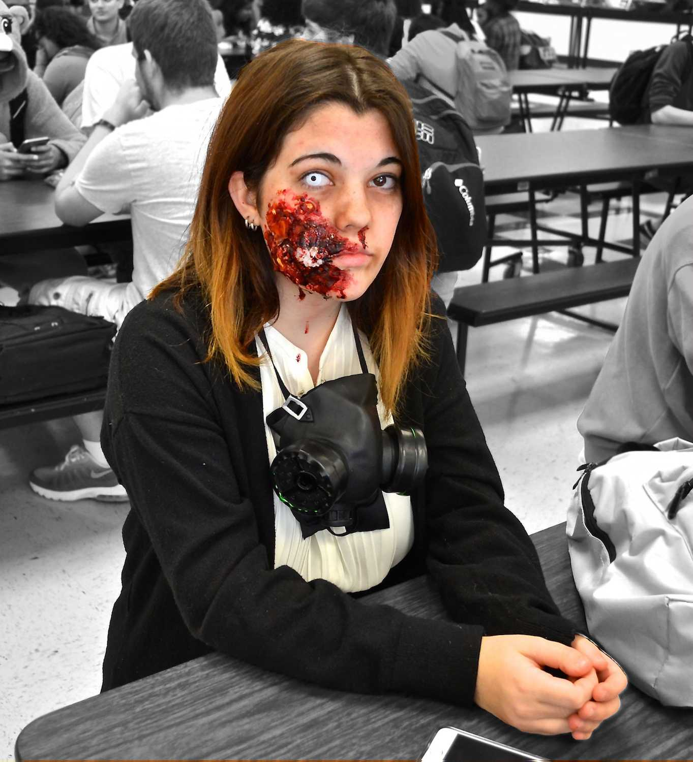 "Wearing a scare-worthy costume, junior Grace Hannah woke up at 4 a.m. to perfect her zombie makeup. NC allows students to dress up in their spookiest trick-or treating attire. On her favorite holiday, Hannah says she's ready to ""walk around and scare children tonight."""