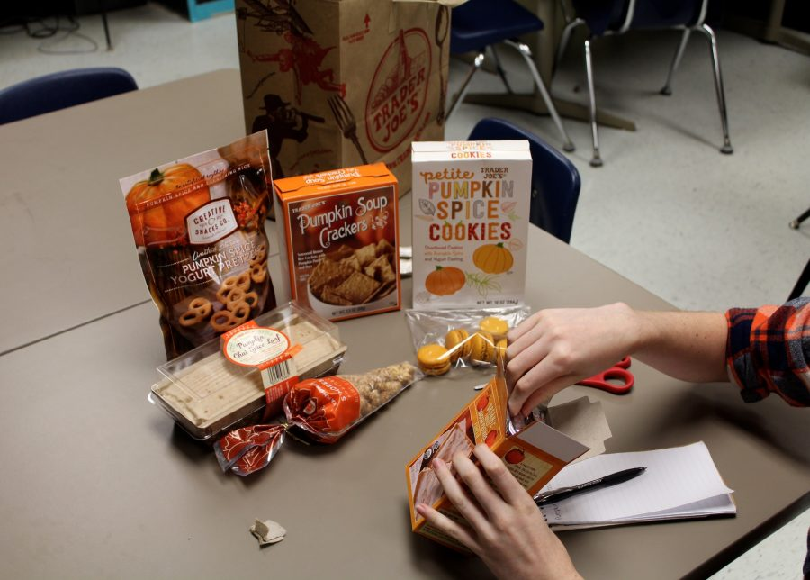 Shambaugh digs into the Trader Joe's Pumpkin Toaster Pastries, surrounded by other fall goodies.