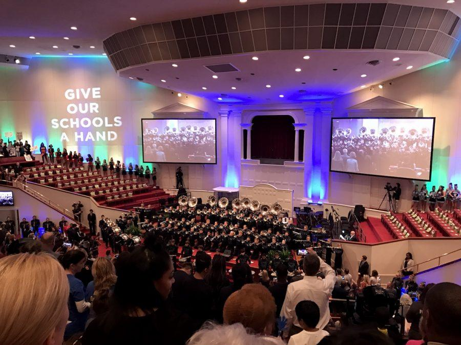 Students from across Cobb County celebrate in the Roswell Street Baptist Church worship center while cheerleaders pep up the crowd and the Harrison High School marching band plays.