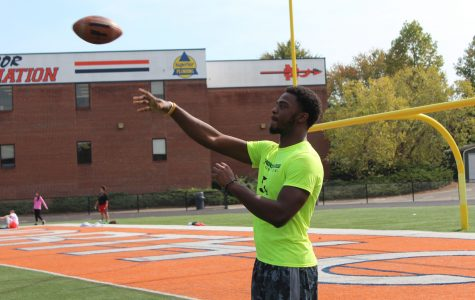 Wooten reflects on his high school football career, throwing the ball with a teammate.