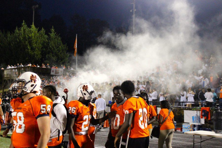 The NC student section celebrates kick-off with the traditional baby powder cloud.